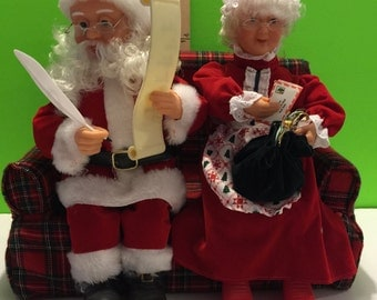 Vintage Animated Claus Couple Making A List