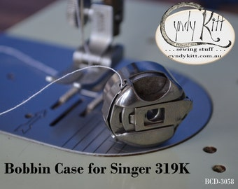 319K bobbin case Part No. 173058
