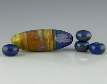 a long oval silverglass focal with blue and tan Double Helix colors handmade lampwork glass bead with spacers - Blue Hills
