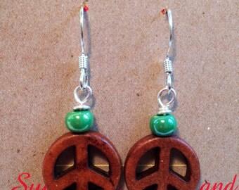 Peace sign earrings.
