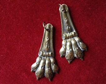 Antique french brass lion paw amulet, talisman, pendant lot of 2