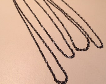 Four dark gunmetal chains