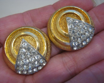 Vintage deco look goldtone clear rhinestone clip earrings, swirling textured round clip earrings, runway glam goldtone clip earrings