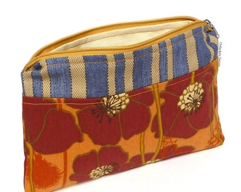 A bold poppy print in rust orange with blue and tan stripes cosmetic bag, make-up bag, gadget bag One of a Kind