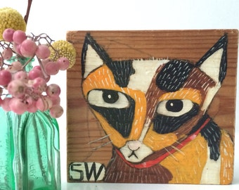 Little painting on reclaimed wood of a grumpy kitty
