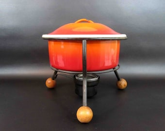Vintage Danish Style Enamel Dutch Oven in Orange Ombre with Wood Ball Footed Stand. Circa 1960's.