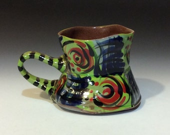 Checkered red and blue on copper green mug striped handle