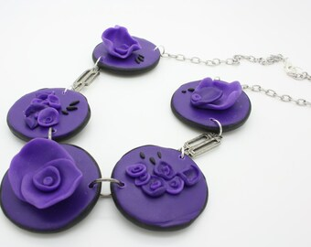 handmade polymer clay five purple flowers on purple disc necklace