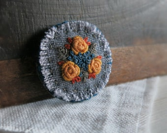 Textile Art Brooch - Mustard Roses With Dark Teal and Rust Details Embroidered on Grey Linen - Gift Under 30 - Handmade by Sidereal