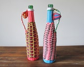 Pair of Woven Gimp Plastic Wicker Wine Bottles 1960s