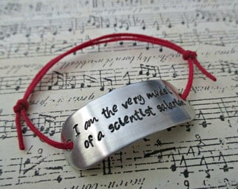 i am the very model of a scientist salarian - hand stamped mass effect mordin solus inspired aluminum adjustable cord bracelet
