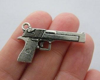 2 Gun charms antique silver tone G76