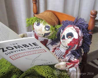"""Custom-made """"Maggoty Ann and Andy"""" zombie dolls"""
