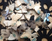 Gorgeous ceramic butterfly artwork. Turquoise and blue smoke fired Indoor, outdoor to decorate a wall in your own arrangement.