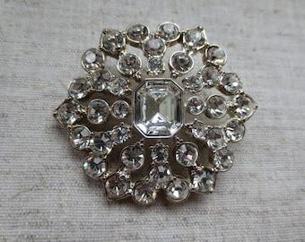 "Beautiful vintage crystal rhinestone Monet silver tone floral design brooch pin. Perfect ""something old"" for wedding bridal sash or belt"
