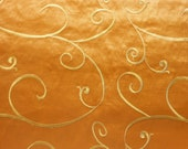 Fabric by the yard, embroidered silk in rust  with gold swirls, one yard.