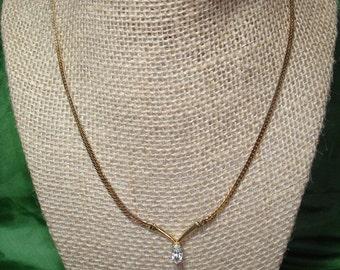 1989 AVON Serpentine Rhinestone Necklace.