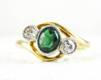 Green Tourmaline & Old European Cut Diamond Engagement Ring, Bypass Design. Circa 1930s, 18 Carat Yellow Gold.