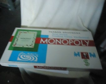 Vintage Monopoly Board Game from 1961, collectable, not complete, properties, money, dice, tokens