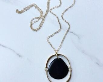 Geometric Pendant Necklace. Circle Necklace. Minimal style.  Gold necklace. Black gold Necklace. Sela Designs. Simple long. Tagua necklace