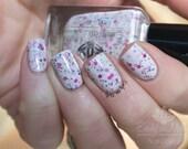 """Nail polish - """"Sakura""""  Black and pink dots in a dark purple jelly base"""