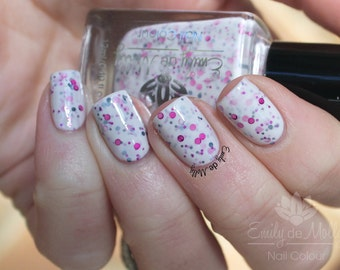 "Nail polish - ""Sakura""  Black and pink dots in a dark purple jelly base"