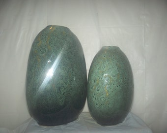 Twin vases lime green  12 inches is the tall/smaller on 10 inches