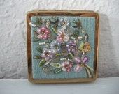 Vintage compact with embroidery