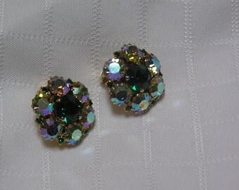 Vintage Warner elegant green and aurora borealis rhinestone flower Clip Earrings