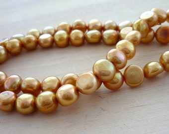 Centre drilled caramel button pearls 6-7mm 1/2 strand