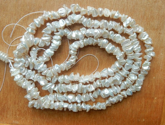 Creamy white, middle drilled   keishi freshwater  pearls (4-7mm),full strand (16 inches), small corn flake pearls