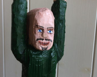 Carved wooden character, definitely not my friend James, as James has green eyes,