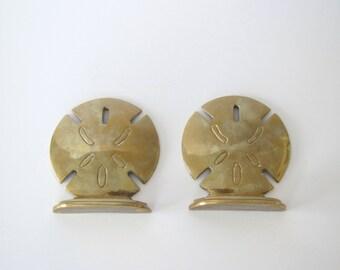 Mid century brass bookends/ sand dollar