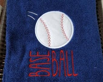 Tossed baseball appliquéd bathtowel.