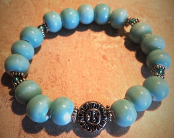 Turquoise ceramic beaded sun & moon bracelet