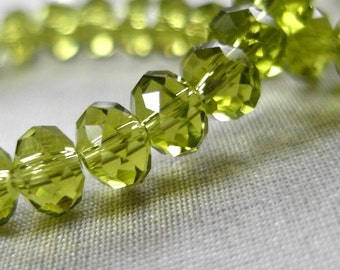 "6mm Olivine Green Faceted Crystal Rondelle Beads, 6mm x 4mm, 7.5"" Strand, 49-50 beads"