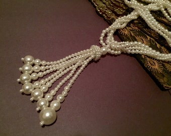 Long multi-strand beaded necklace with tassel
