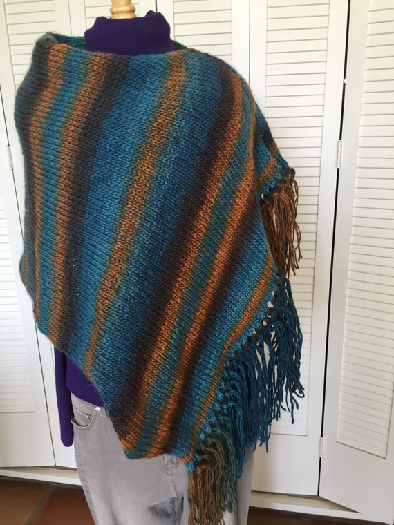 Colors of the Southwest.  Poncho with shaded fringe.