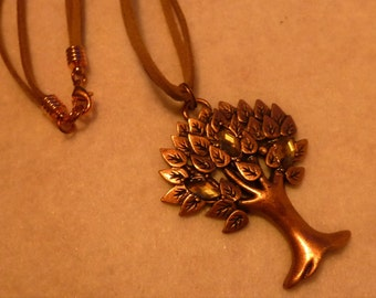 Long necklace: copper coloured tree of life pendant with rhinestones on a long faux suede cord