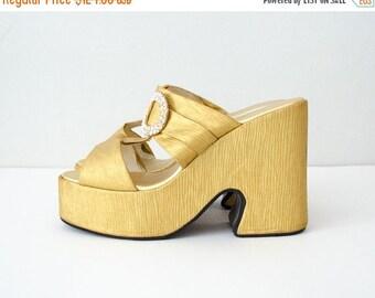 25% OFF SALE / 1970s vintage shoes / gold lamé mega platforms / size 8