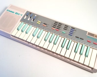 The Holy Grail of Nerdom The Pink Casio SK-1 Sampling Keyboard SK1 sampler with case