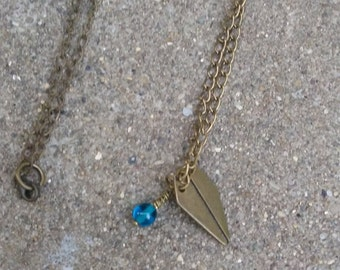 Long antique brass paper airplane necklace with turquoise Czech bead