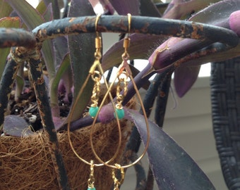 Gold tear drop earrings with turquoise beads