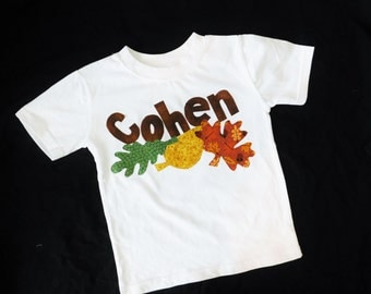 Boy or girl, toddler, and baby long sleeved knit shirt with fun fall print autumn leaves and personalized name applique in sizes NB - 16