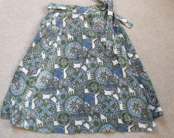 Vintage handmade cotton wrap skirt in a blue green & white print.