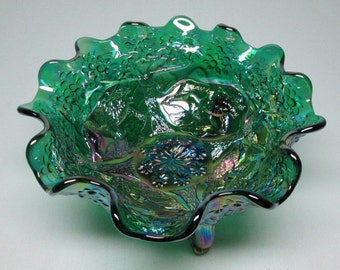 Fenton glass bowl with lions and trees , three feet green . marked carnival glass