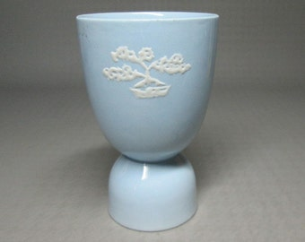 Johnson Bros Greydawn blue egg cup with a white decoration that looks like a little bonsai tree graydawn