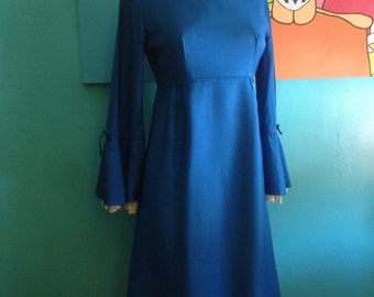 Vintage 1960s empire waist dress with lace bell sleeves