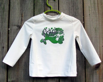 CLEARANCE. Hand stamped mermaid rashguard swim shirt, 18 month size. White shirt stamped in green and purple.