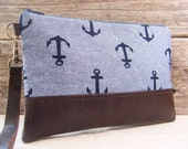 Large Wristlet in nautical fabric with anchors and faux leather accent  wristlet with leather strap  wallet with zipper, bag for cell phone.